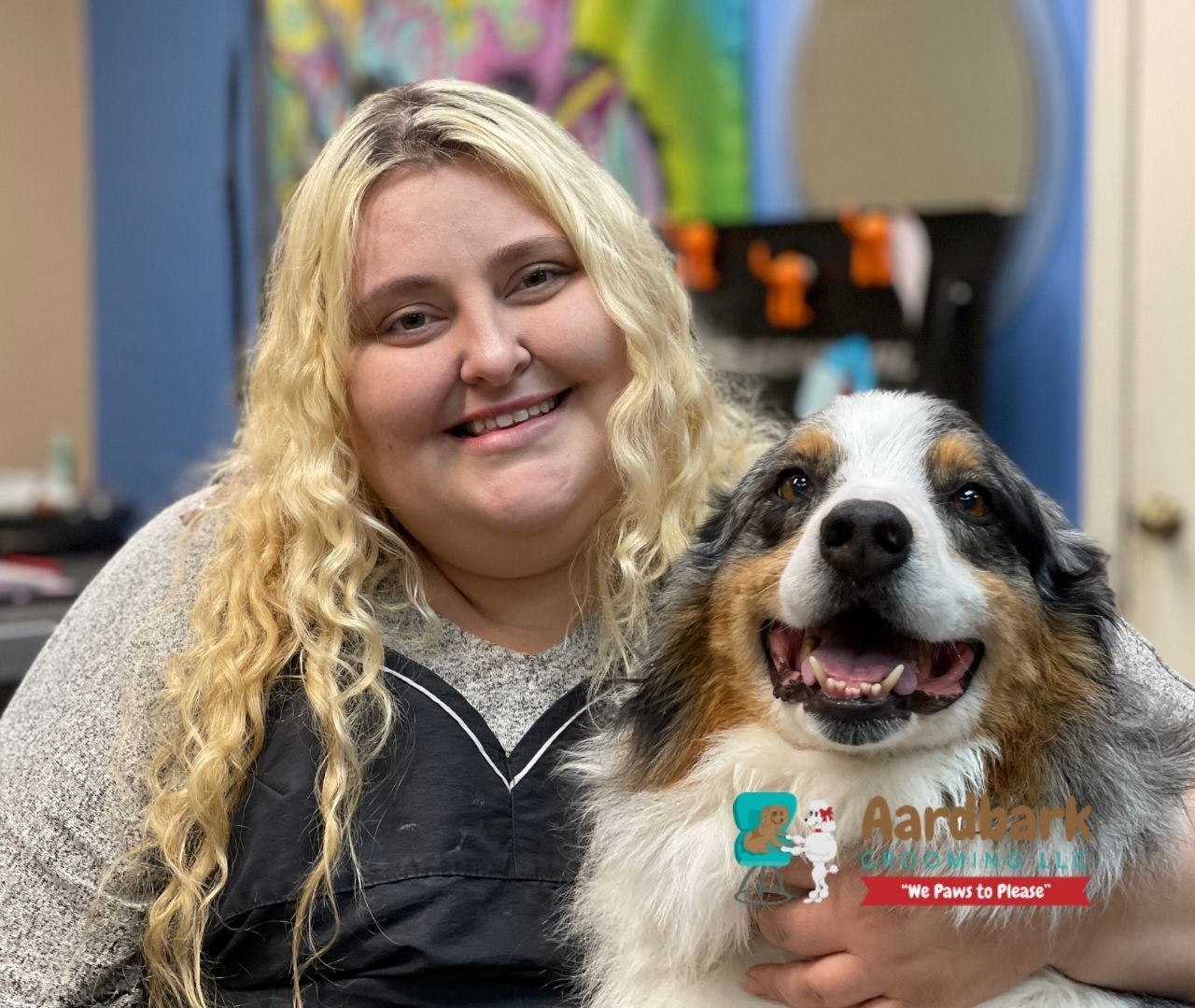 aardbark dog grooming staff member with groomed dog